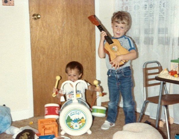 carrozzo brothers playing toy instruments as children